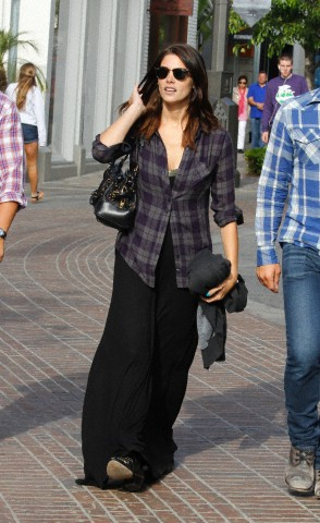 Ashley Greene and a male friend shop at The Grove in West Hollywood, California