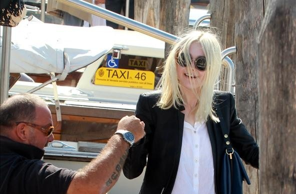 Dakota Fanning arrives in Venice, Italy