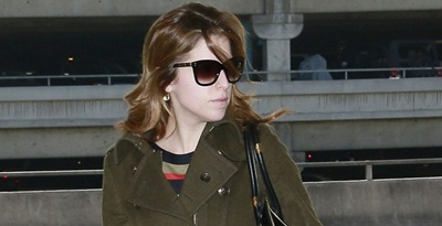 **EXCLUSIVE**  ROUGH MORNING? A tired looking Anna Kendrick goes makeup-free as she gathers her things to catch a flight out of Los Angeles